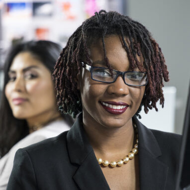 two professional women in an office