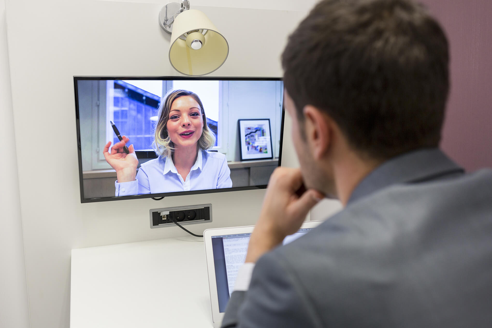 Business woman on video conference demonstrating how to train transcribers in a remote learning office environment