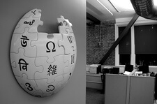 3-dimensional wikipedia logo mounted on an office wall