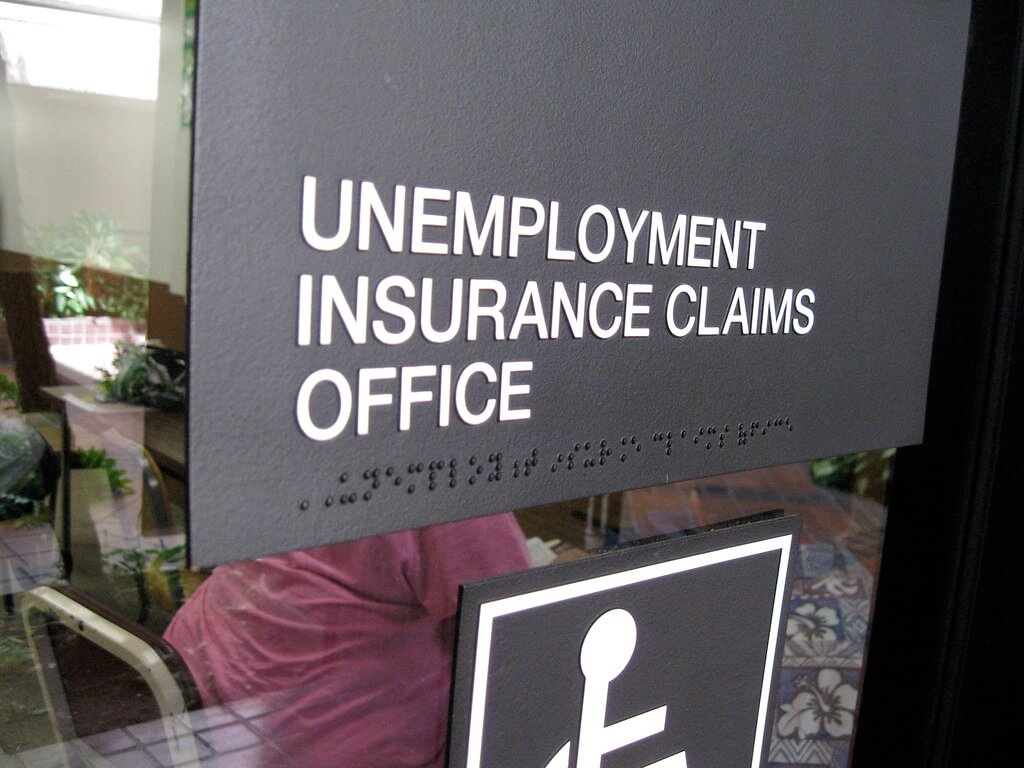 "Unemployment Resources for COVID-19 include visits to DES offices with signs that read ""unemployment insurance claims office"""